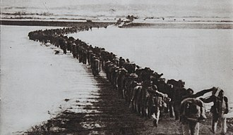 Battle of Kujin - Chinese forces cross the Yalu River.