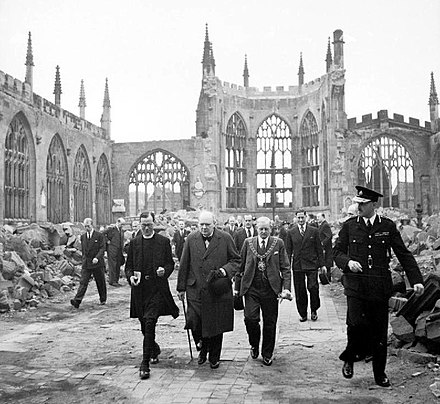 Churchill walks through the ruins of Coventry Cathedral with Alfred Robert Grindlay, 1941 Churchill CCathedral H 14250.jpg