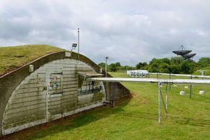 Cambridge Optical Aperture Synthesis Telescope - Part of COAST and the exterior of its bunker in June 2014