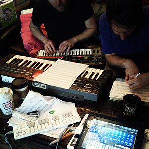 Musical composition - People composing music using synthesizers in 2013.