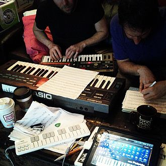 Music - People composing music in 2013 using electronic keyboards and computers.