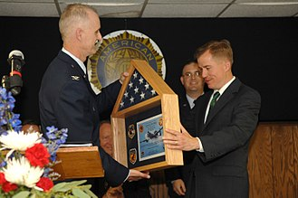 Matt Blunt - Col. Steve Arthur presents Missouri Governor Matt Blunt with an American flag flown on a combat mission over Afghanistan and certificate following a bill-signing ceremony in Warrensburg, Missouri in 2008