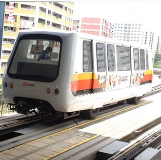 Light Rail Transit (Singapore) - A new Bombardier INNOVIA APM 100 running on the guiderails, in SMRT new livery.