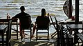 Couple in Seafront Restaurant - 16 x 9 Photo - Kep - Cambodia (48543450402).jpg