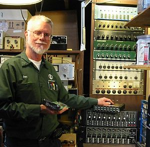 Dan Dugan (audio engineer) - Dugan holds his Yamaha Dugan-MY16 card (2011), and to his left are earlier automixer models