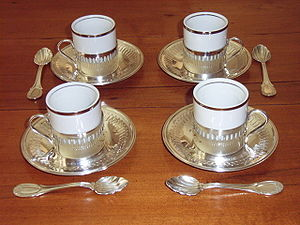 Set of 4 white porcelain demitasse cups in met...