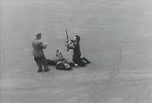 Disarming a dead German during liberation of Paris.jpg