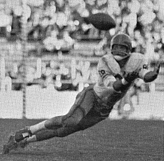 End (gridiron football) - Mike Ditka catching a pass as an end at Pitt.