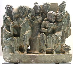 Drinking scene with Dionysus and Ariadne on his lap. Greco-Buddhist art from Gandhara, 3rd century CE.