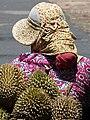 Durian Vendor on Motorbike - Kep - Cambodia (48543484682).jpg