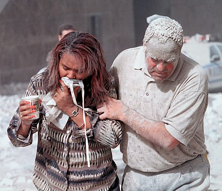 Two survivors are covered in dust after the collapse of the towers. Dust covered 911 victims.jpg