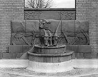 EAST SIDE OF COURTYARD, CENTER (FOURTH FROM LEFT) SCULPTURE PANEL AND FOUNTAIN, LOOKING EAST (Wieskamp) - Dairy Industry Building, Iowa State University campus, Ames, Story HABS IOWA,85-AMES,4-32.jpg
