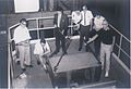 Ed Walsh (in suit) supervises the removal of the shielding from a UTR-10 nuclear reactor at Iowa State University 1962.jpg