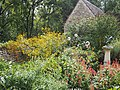 English Limestone Cottage with Garden in full bloom (9708886893).jpg