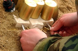 Detonator - Inserting detonators into blocks of C-4 explosive