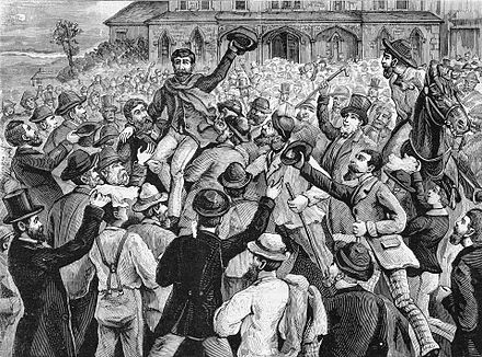 A large crowd outside the Victorian Supreme Court, celebrating the release of the Eureka rebels in 1855 Eureka Rebellion Prisoners Released.jpg