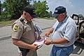FEMA - 30617 - Community Relations worker and Patrolman.jpg