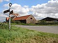 Farm Buildings and Old Signpost West of Walcot - geograph.org.uk - 546914.jpg