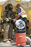 Fire Fighters from the Marine Corps Air Station Beaufort fire department get dress in hazardous material suits to contain a chemical spill at the training pool at Marine Corps Air Station Beaufort, South 130719-M-VR358-034.jpg