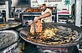 Fish Frying in Pakistan - Fried Fish in boiling oil is a traditional food in winters.jpg