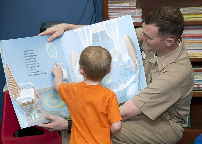 File:Flickr - Official U.S. Navy Imagery - A Sailor talks to a child during story time at Naval Base Guam..jpg