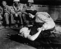 Flight nurse Jane Kendeigh caring for wounded soldier on Iwo Jima--1945.jpg