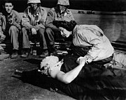 Flight nurse Jane Kendeigh caring for wounded soldier on Iwo Jima--1945