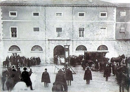 Public execution on Guillotine; Picture taken on 20 April 1897, in front of the jailhouse of Lons-le-Saunier, Jura. The man who was going to be beheaded was Pierre Vaillat, who killed two elder siblings on Christmas day, 1896, in order to rob them and was condemned for his crimes on 9 March 1897. France - Public execution on Guillotine 1897.jpg