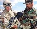 GI shows an Afghan officer an M16.jpg