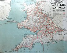 "A map showing Wales and south west England. The words ""Great Western Railway"" are at top left, the sea is pale blue and railway lines red, many of which seem to radiate from London on the right"