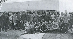 Military attachés and observers in the Russo-Japanese War - Japanese General Kuroki Tamemoto and his staff were photographed with Western military attachés and war correspondent observers after the Battle of Shaho (1904).  The most senior of the military attachés, Gen. Sir Ian Hamilton, center, stands with left hand in a coat pocket and a stick tucked under his right arm.