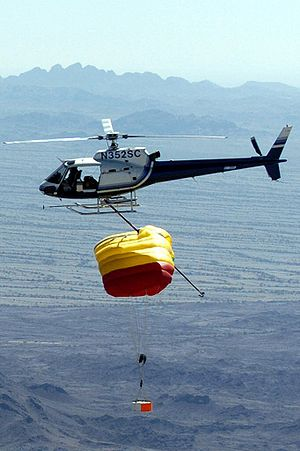 Mid-air retrieval - A helicopter with a long hook can catch a parachuting object in mid-air, as seen here in a practice run for the planned retrieval of Genesis.
