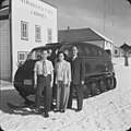 George Mah, Mrs. Mah, and Charlie Mah (Mah Shaw Hing) standing in front of a snow mobile in Fort Chipewyan, Alberta (38629113115).jpg