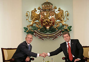 Coat of arms of Bulgaria - Former President of the Republic of Bulgaria Georgi Parvanov and President of the United States George W. Bush in front of the coat of arms in Sofia, June 11, 2007.