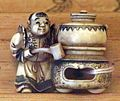 Giappone, periodo edo, netsuke (fermaglio per inroo), xix secolo, 019 uomo alla pentola sul braciere.jpg