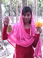 Girls retain Mucuna pruriens fruits and Marigold flower.jpg