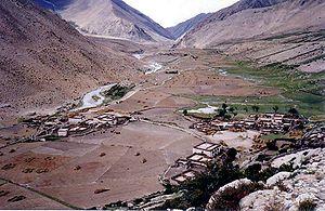 Milarepa - Overlooking Pelgyeling Gompa at Milarepa's Cave, Tibet.