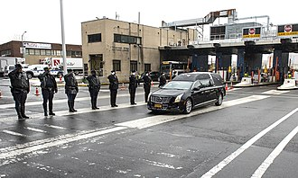 Mario Cuomo - Officers of the Metropolitan Transportation Authority and a state police honor guard saluting Cuomo's hearse as it passes through the Queens Midtown Tunnel, January 6, 2015