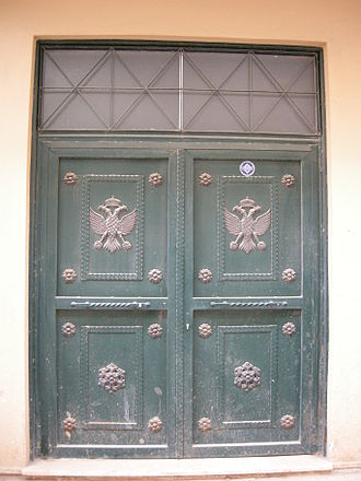 Maniots - A characteristic door with the symbol of the double-headed eagle in Gytheio.