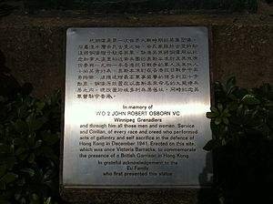 Memorial plaque dedicated to all the defenders of Hong Kong in December 1941 through John Robert Osborn and to commemorate the British Garrison at Hong Kong. HK Central Xiang Gang Gong Yuan Hong Kong Park memory of John Robert Osborn bronze statue sign Nov-2013.JPG