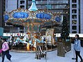HK Central Statue Square Gardens Chritmas Tiffany Carousel visitors evening Dec-2012.JPG