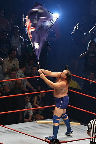 Jim Duggan - Duggan waving an Australian flag during his ring entrance in Australia, 2007, with his 2x4 in the corner