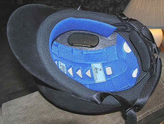 Equestrian helmet - The inside of an ASTM/SEI-approved helmet, showing padding, ventilation system, adjustment mechanisms, and part of the harness.