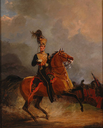 Army officer on horseback.