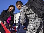 Hillary Paulino, left, looks on as her husband, U.S. Air Force Airman 1st Class Michael Paulino, an ammunition technician with the 366th Equipment Maintenance Squadron, hugs their daughter at Mountain Home Air 131003-F-WU507-164.jpg