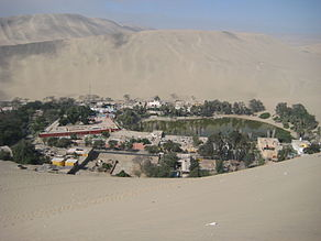 Huacachina in Peru, as seen from one of the sand mountains.jpg