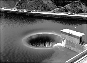 Spillway - Bell-mouth spillway of Hungry Horse Dam in operation.