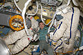 ISS-20 Koichi Wakata between two Russian Orlan spacesuits in the Pirs Docking Compartment.jpg