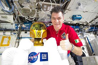 Paolo Nespoli - Expedition 26/27 flight engineer Paolo Nespoli poses with Robonaut 2.