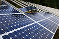 Installing solar panels (3049032865).jpg